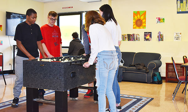 [PIC] Alternative High School Students Play Foosball In The New Recreation Room