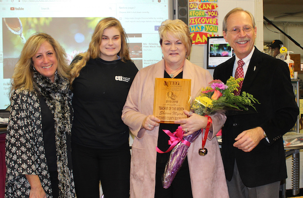 [PIC] Cosmetology teacher Sharon Myers being presented with Q92 Teacher of The Month Award