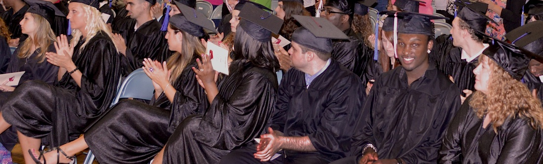 3.	Graduates applauding at graduation